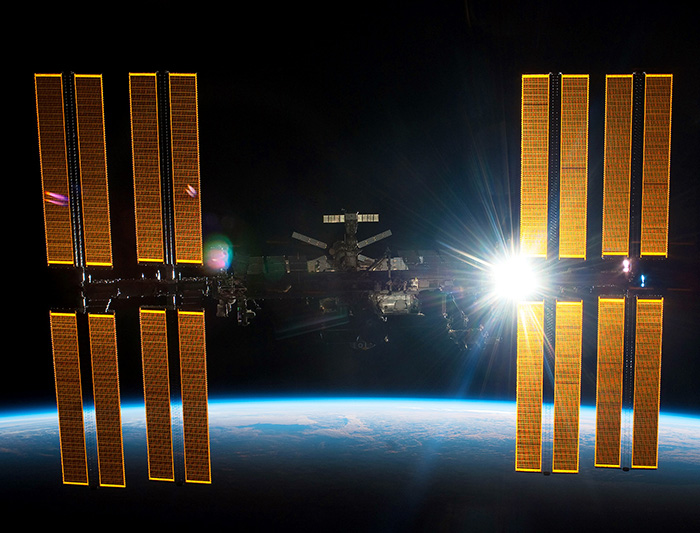 Photo rights: http://betterarchitecture.files.wordpress.com/2013/06/international-space-station-solar-cells.jpg