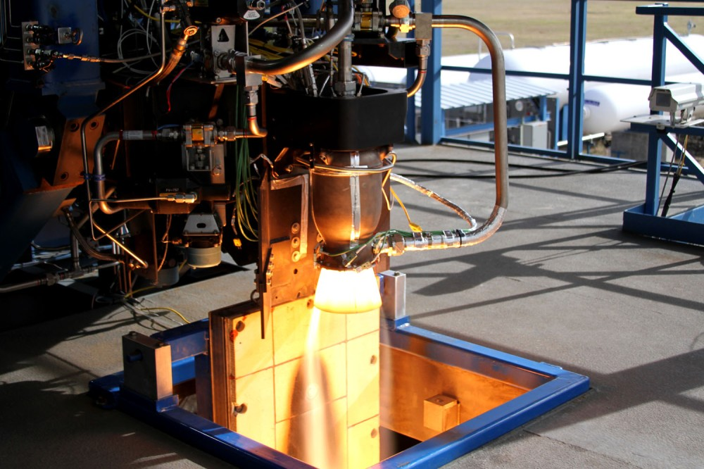 The 3D printed SuperDraco engine is designed and manufactured in-house.  Altogether eight SuperDracon engines fitted to the Dragon V2 can produce 120,000 pounds of thrust and throttle between 20-100%.  Photo rights: SpaceX.