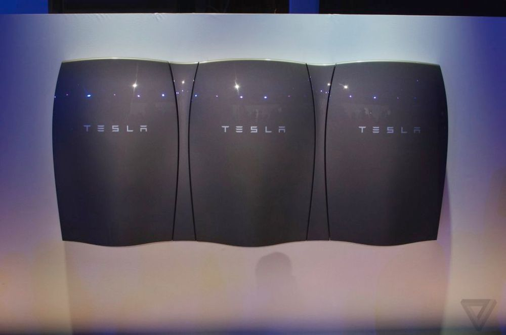 Tesla Energy | Three Powerwall units nested in a unifying frame. Image rights: The Verge.