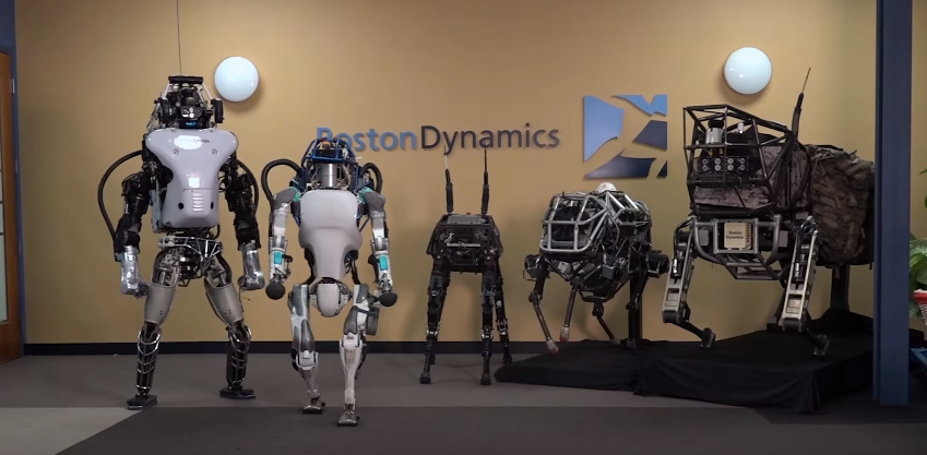 The line-up of just several of Boston Dynamic's robots. Image via Boston Dynamics' YouTube video.