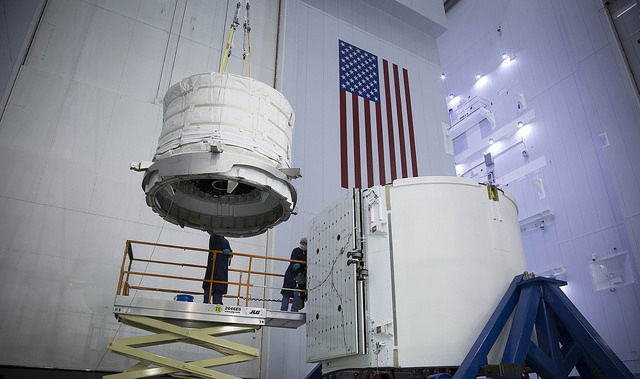 Expandable habitat from Bigelow Aerospace being lifted into Dragon's trunk for a ride to the space station. Image via SpaceX.